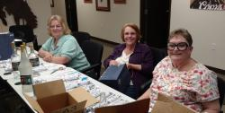Committee hard at work!  Cheryl might have had a nip or two!!!  L-R: Cheryl Couch Tottenhoff, Anita Venneman and Lois Ha