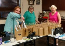Anita, Sharon and Dee working on the East gift bags.  L-R:  Anita Venneman, Sharon Holthuson Cloyd and Dee Graeber Patte