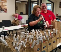 Cheryl and Bill working on the Central gift bags.  L-R:  Cheryl Couch Tottenhoff and Bill Arnold